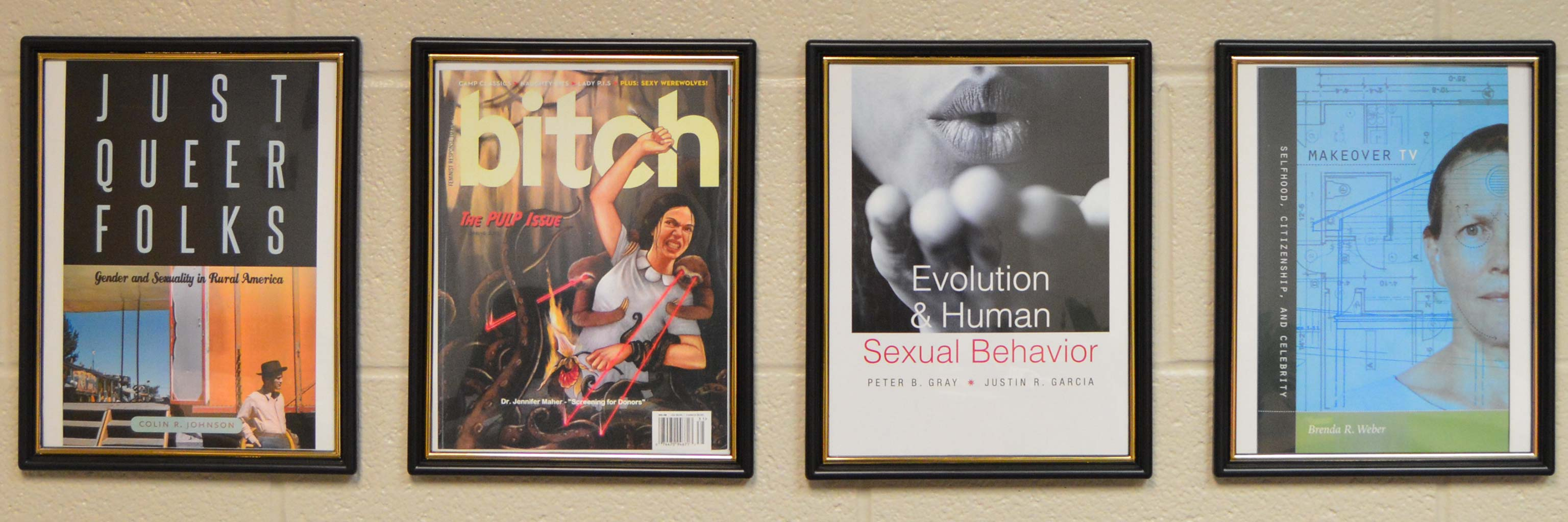 framed publications hanging on a wall